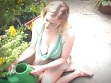 busty blonde in garden