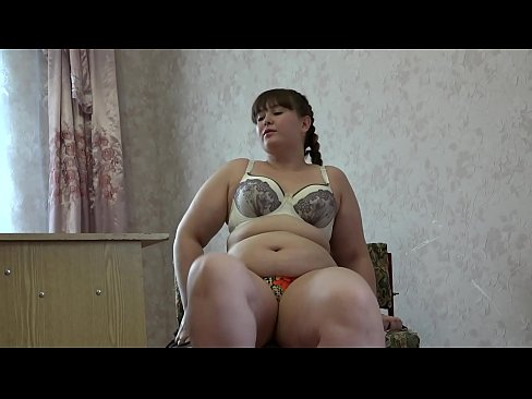 A fat girl is measuring different bras and masturbating her pussy