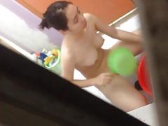 Asian taking Shower